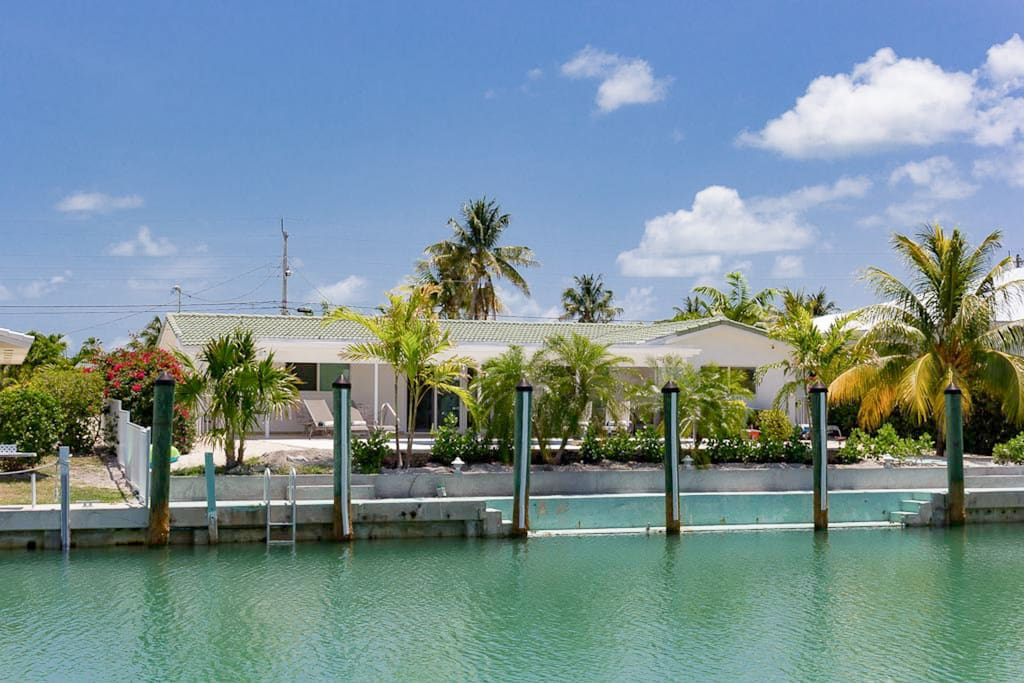 A view of your Key Colony Beach home from the canal. Professionally managed by TurnKey Vacation Rentals.
