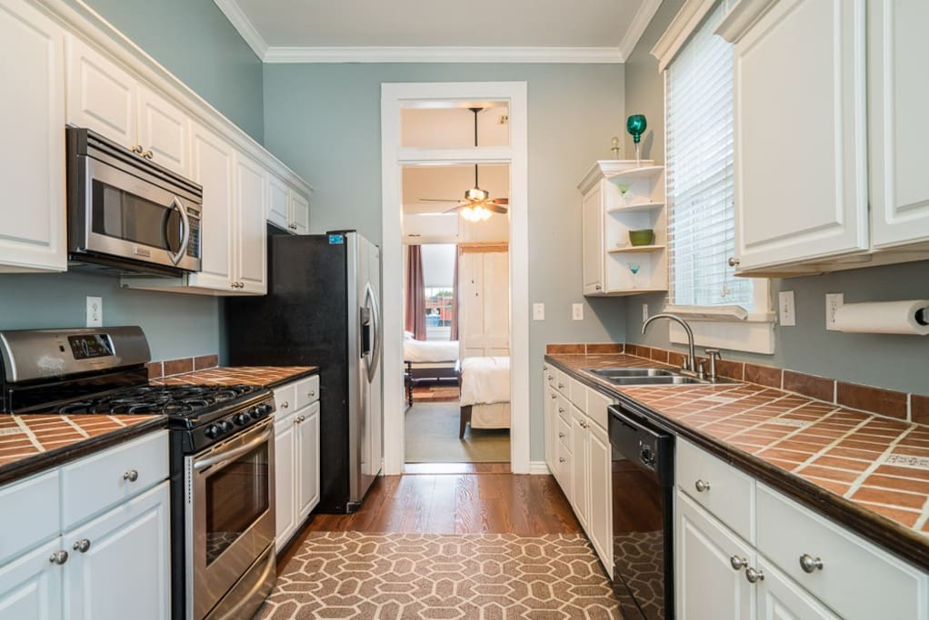 Fully equipped kitchen with fridge/ice maker, gas range, microwave and dishwasher plus all cooking needs