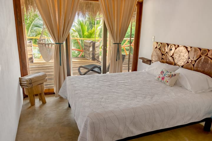 Double bedroom with private terrace lagoon view