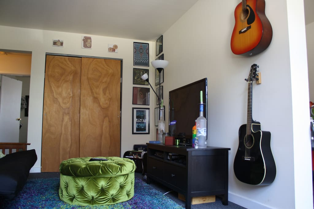 Living room. TV w/ wifi and netflix. Guitars to use at your careful leisure