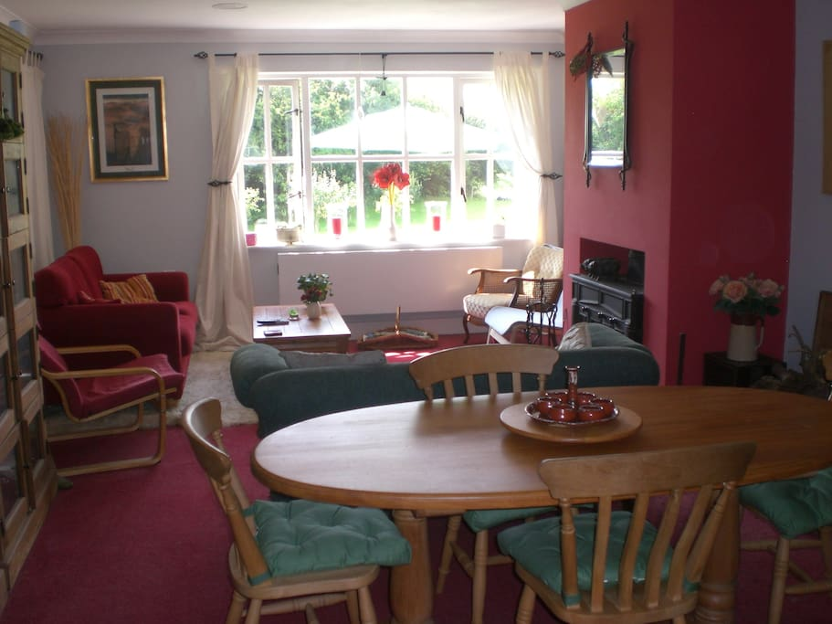 Private guest lounge with log burner and flat screen TV