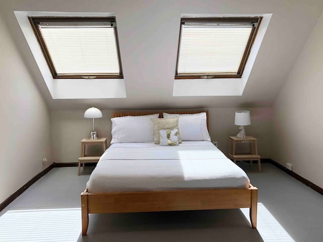 Unwind in a Charming Apartment with Skylights