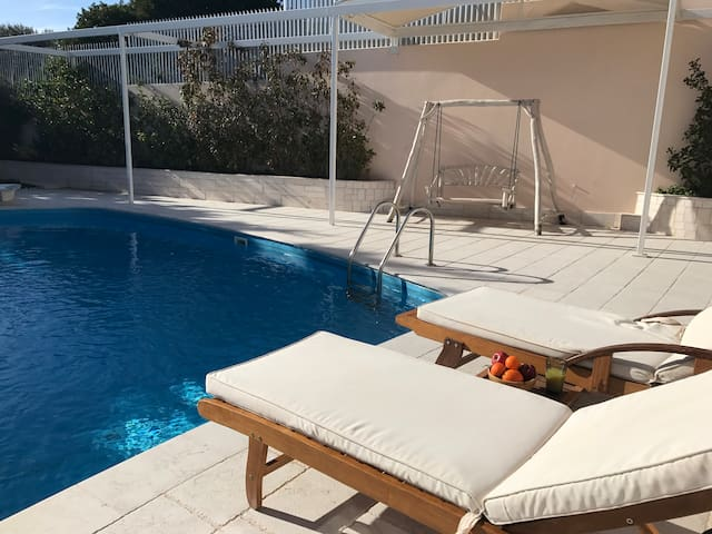 Greek style holiday at a two story sea view villa