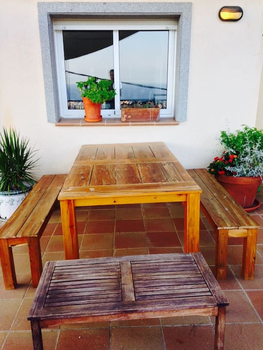 Outdoor Table by Kitchen and Pool.