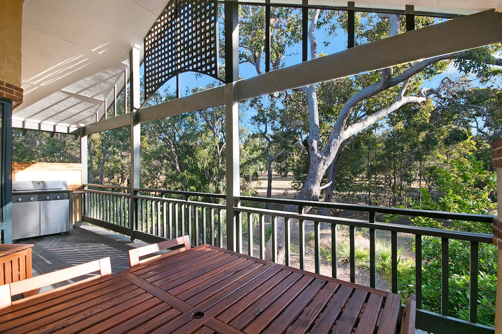 Enjoy a BBQ and a wine overlooking the bushland