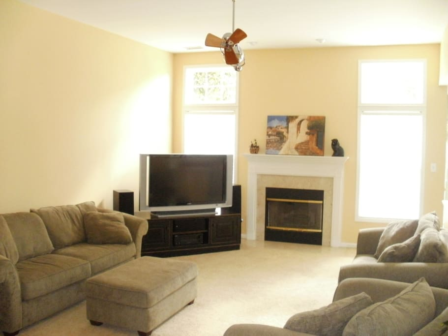Comfortable living room with big screen tv and surround sound throughout the house.
