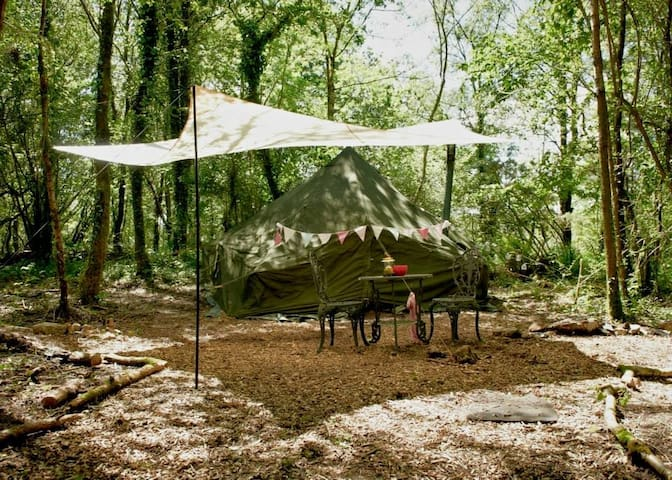 Army bell tent in private area