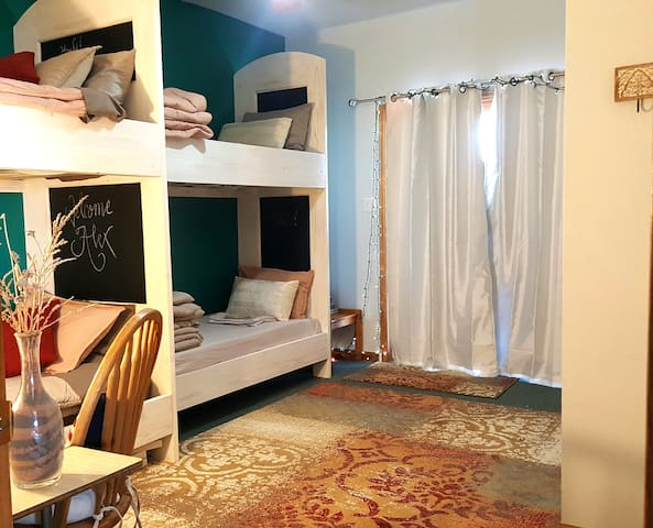 Custom built bunks with plush mattress' and bedding for 4 adults or kids! Entrance/Exit patio doors. Kick safety lock