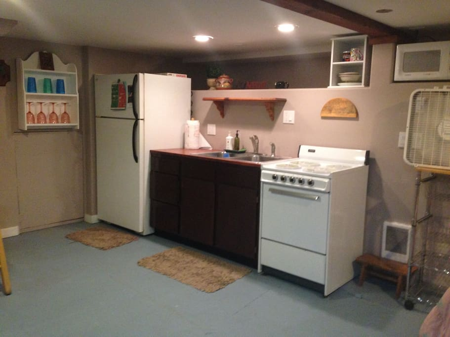 Full kitchen with mircowave, blender, electric kettle, and coffeemaker