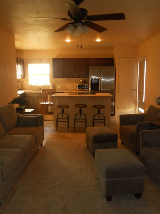 View of living room and kitchen from second bedroom.