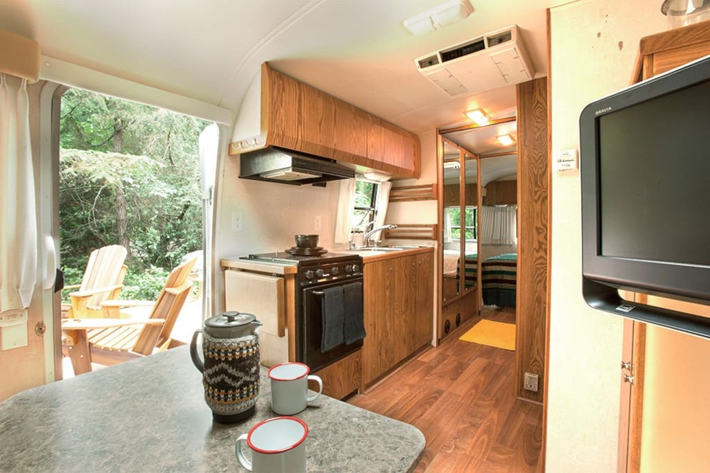 Full kitchen with 3 burner cooktop/oven, microwave and full size fridge.