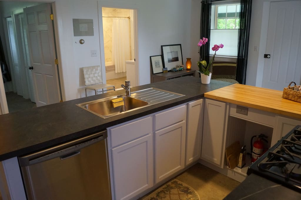 Kitchen includes microwave and dishwasher.