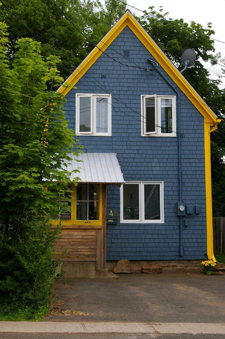 The Li'l Blue House from the street. Two free parking spaces.