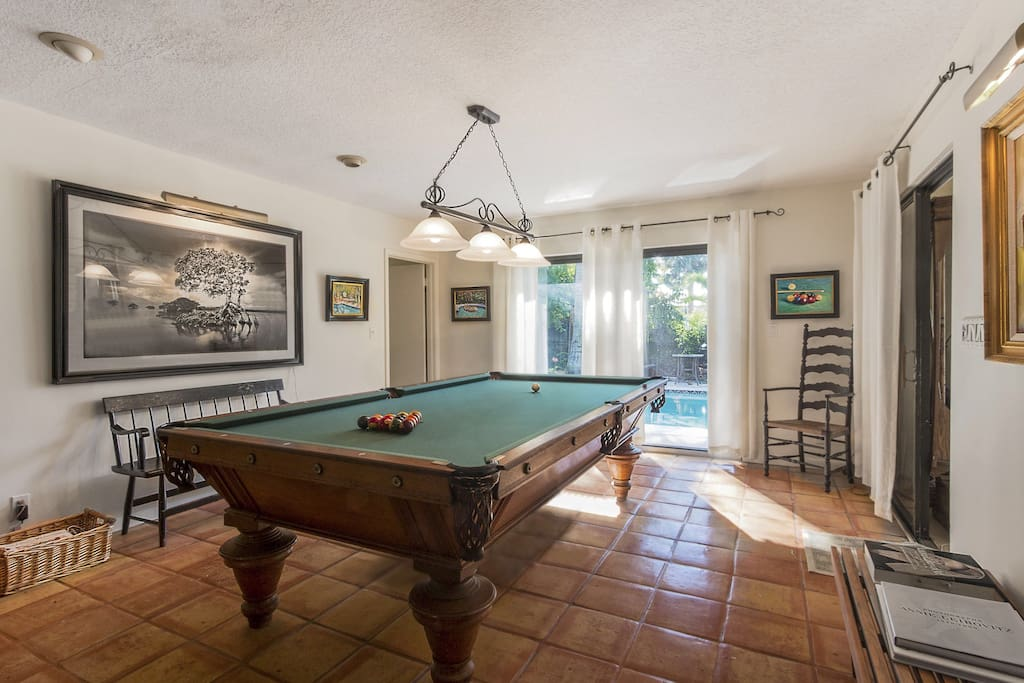 Oversized antique pool table for your use.
