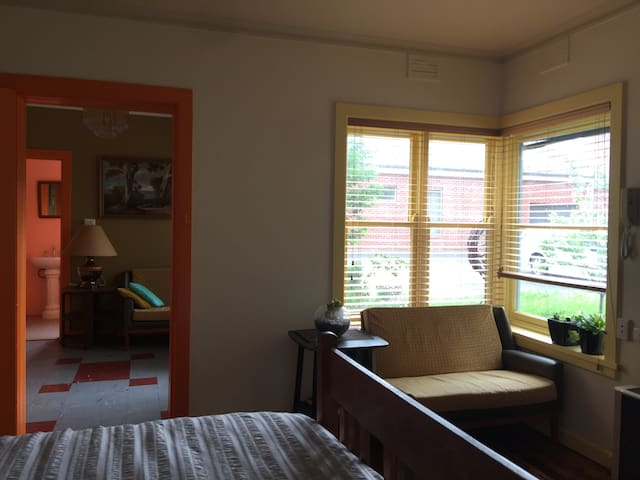 Comfortable second room, antique queen bed, with view North-West to garden. Place to sit to watch TV (Netflix and Stan on Apple TV, fast internet). (Please book for 3+ if you want us to make this bed up).