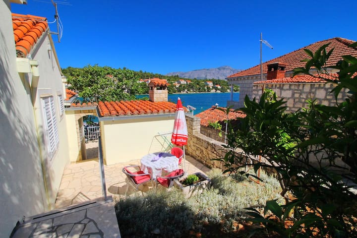 Apartments Val, Lumbarda - One Bedroom Apartment with Terrace and Garden View