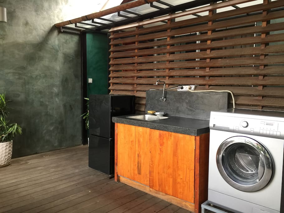 Open terrace with Refrigerator, sink, Electronic cook  and washing. marchine
