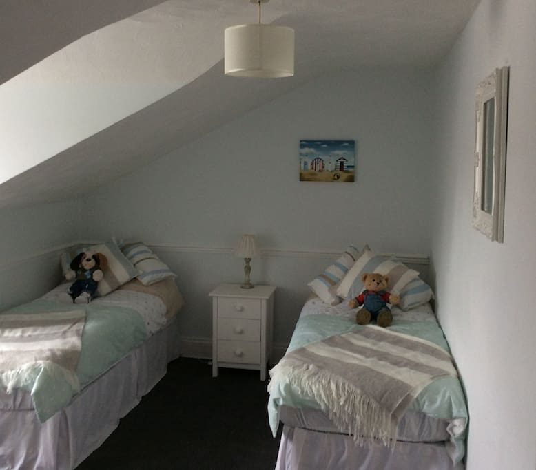Attic bedroom with views of the rear.  Can be a double or twin room.