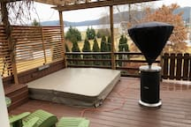 Deck with outdoor heater and hot tub
