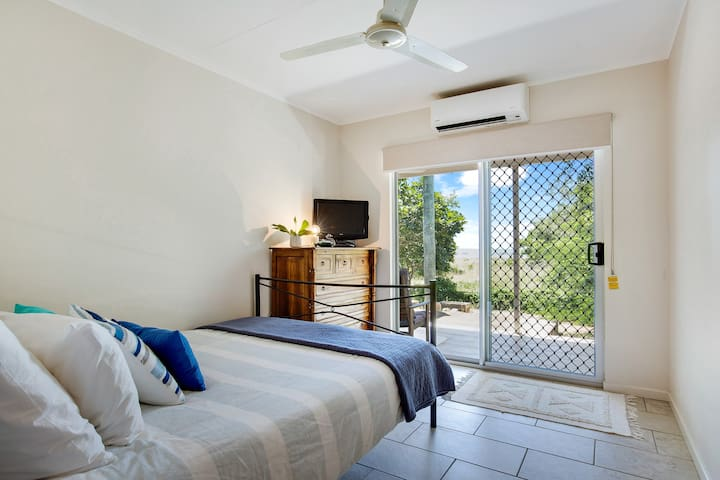 The second beachfront bedroom also opens to the verandah
