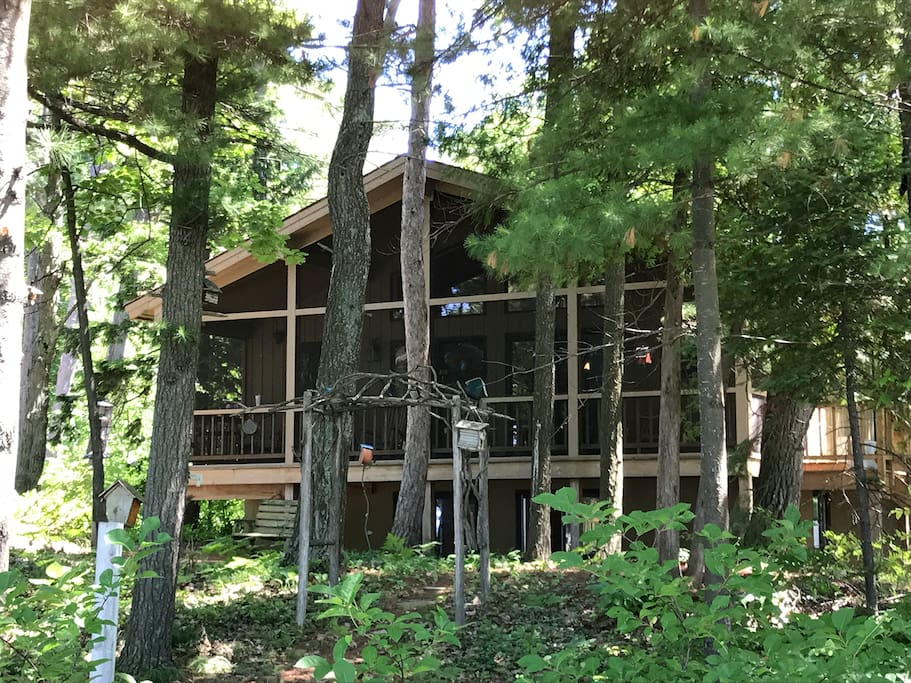 Front view of the house, which faces the bay. The screened-in deck stretches along the entire front.