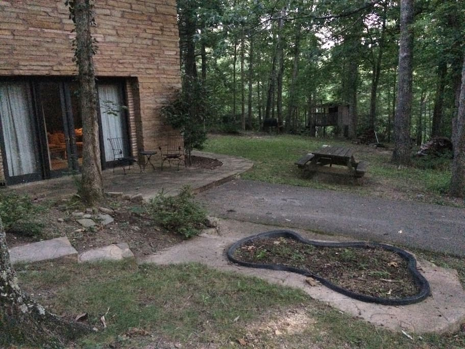 Located on a scenic wooded property guests have their own grilling and campfire area.