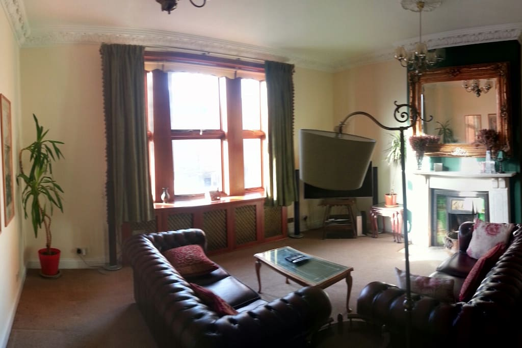 Massive living area with chesterfield sofas