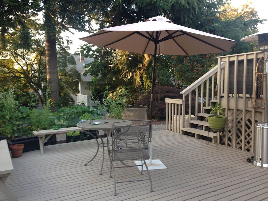 Backyard - with umbrella, patio heater and a fresh garden to pick veggies from!