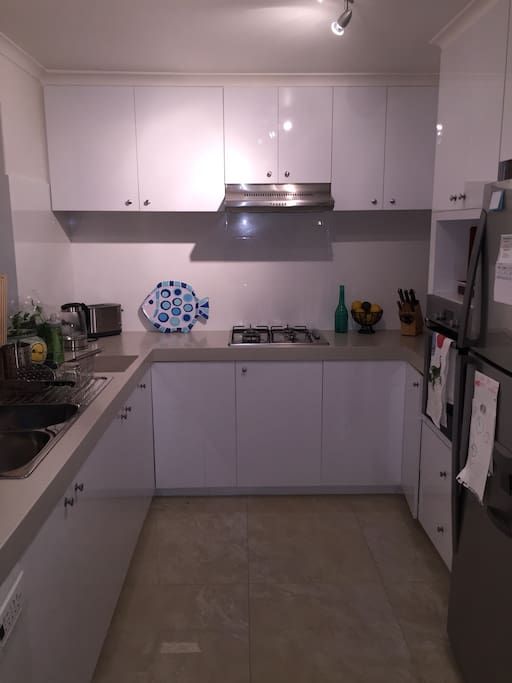 Spacious and fully equipped kitchen for cooking.