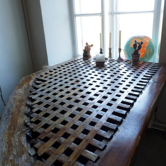 there are some unique interior design solutions. this table has been made out of a deck of a sailing boat, salvaged from the dry dock of suomenlinna