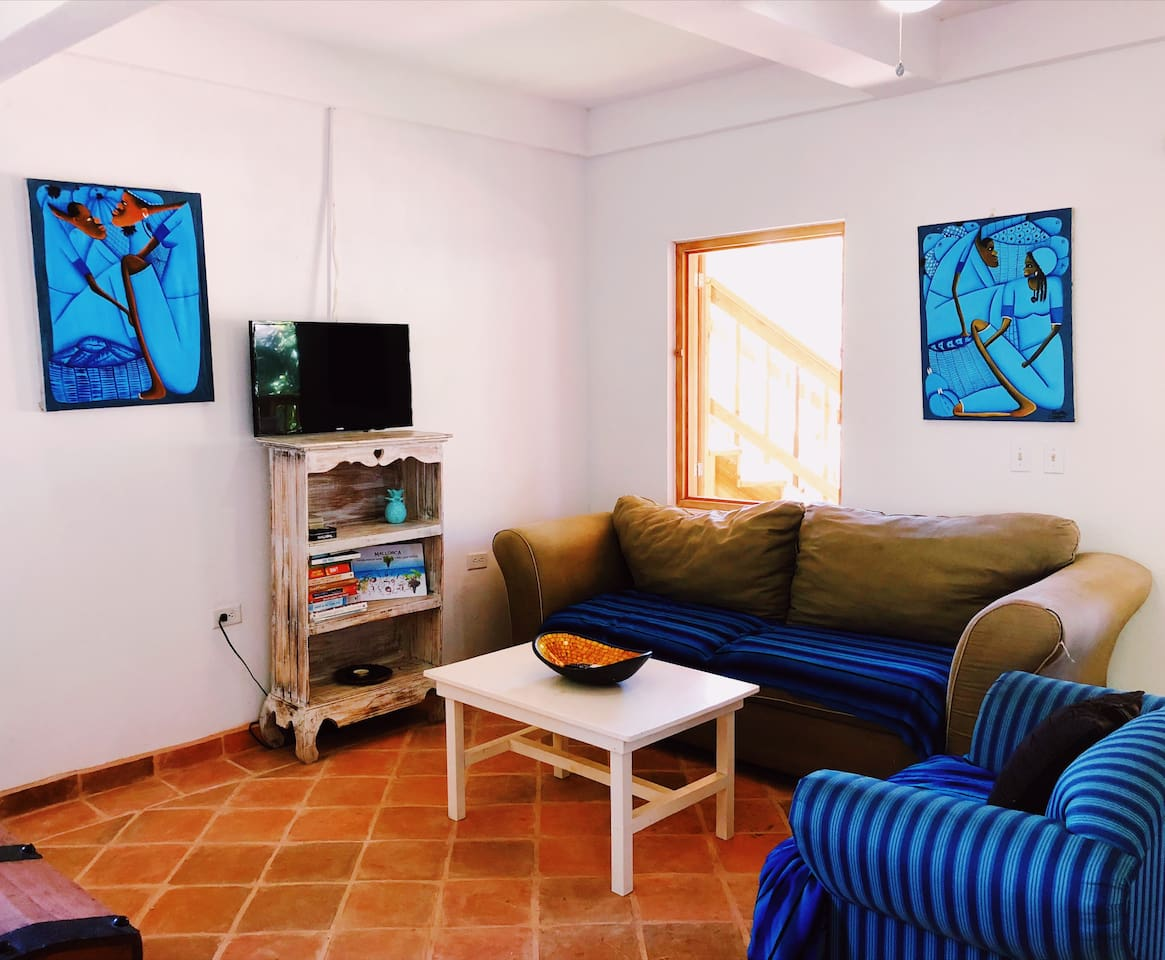 Living area, featuring local artwork