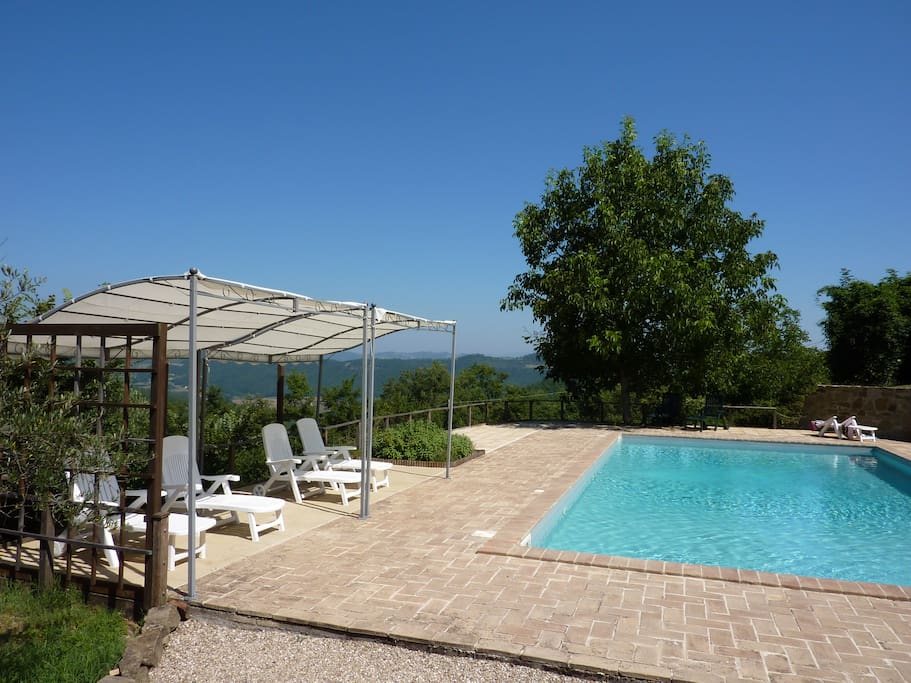 Private 12m by 6m pool set in terraces with great views