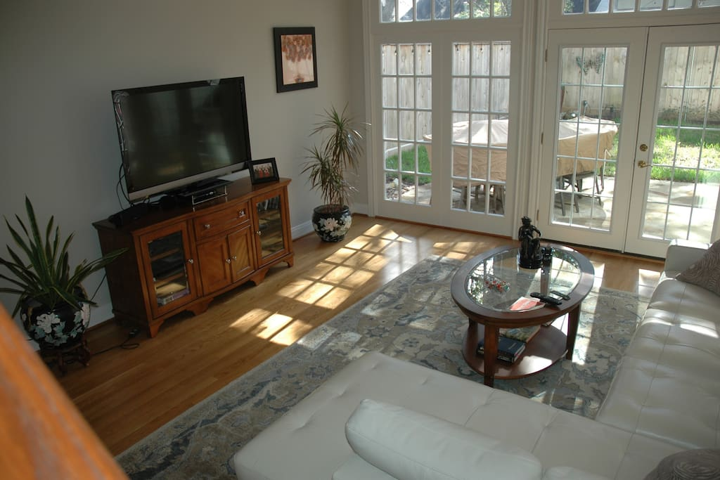 Plenty of room in our family room with an equipped entertainment center and its open to the kitchen
