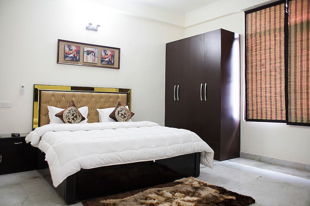 King Bed with Premium Mattress and Attached Bathroom