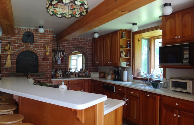 Large, inviting kitchen has all the amenities you could need.