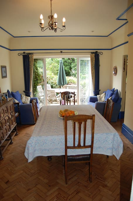 Spacious dining room leading into kitchen and garden.