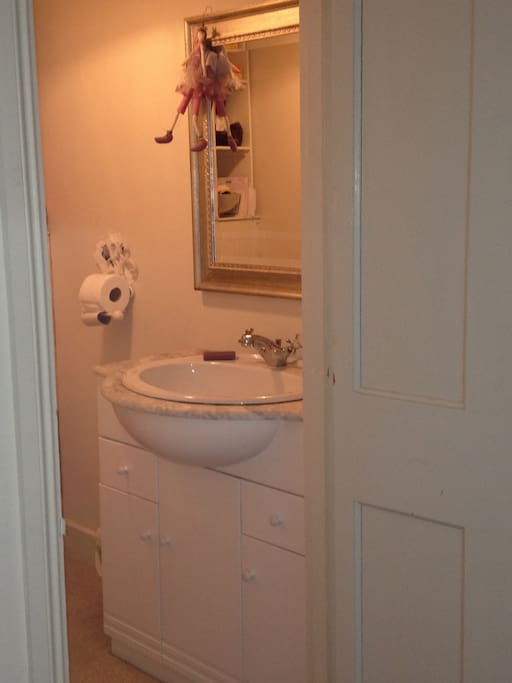 Basic en suite toilet and sink off in adjourning bedroom