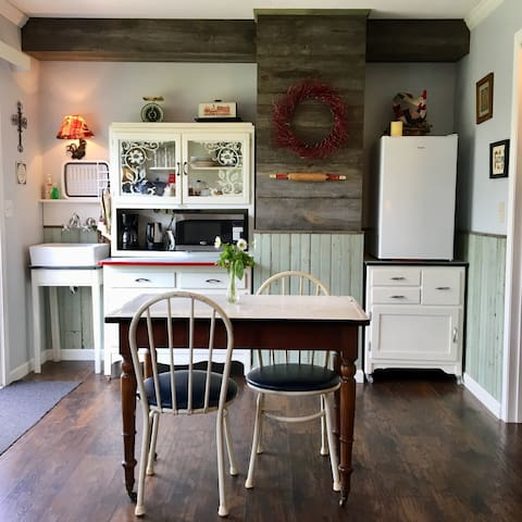 This old-timey kitchen takes you back to the good old days. It's complete with all the modern conveniences: hot and cold running water, microwave and fridge, as well as coffee pot and tea kettle.