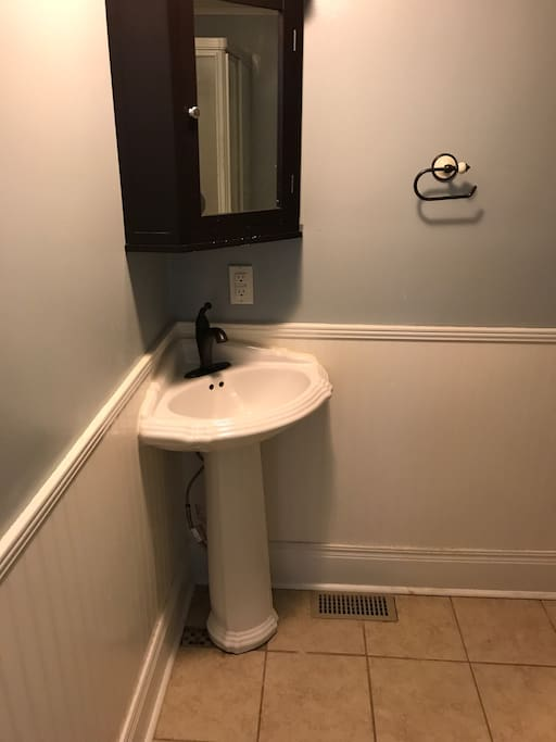 Semi private bath, not attached but on the same floor