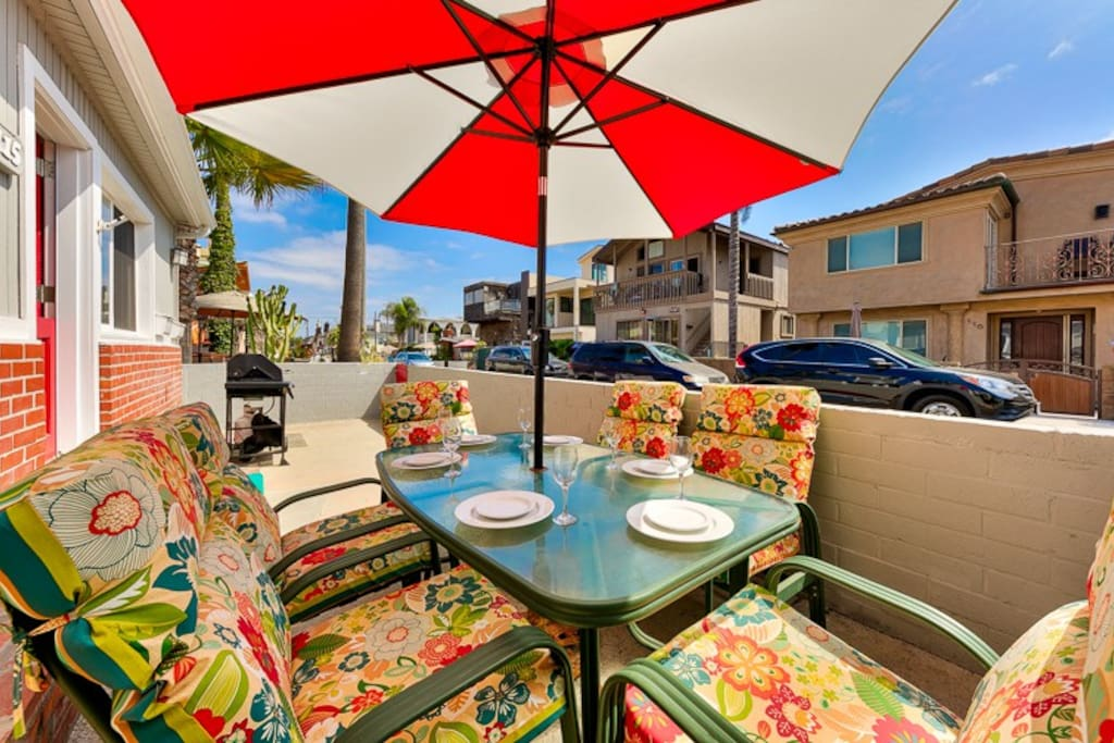Colorful front patio where you can barbecue and dine al fresco or even watch the sun rise with your morning cup of coffee.