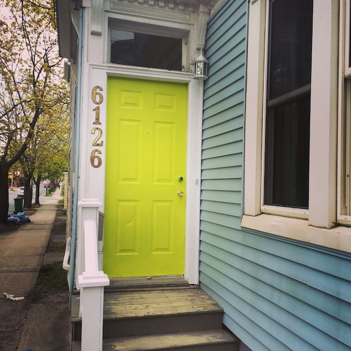 Bright lime green front door to welcome you in!
