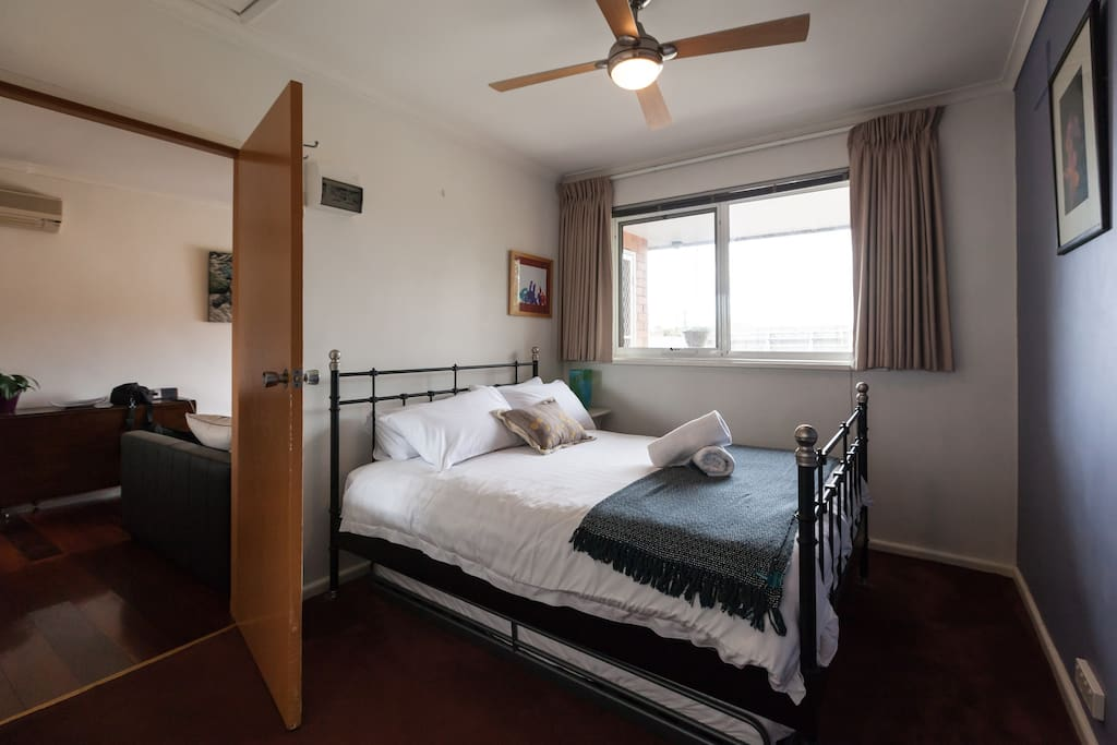 Queen sized bed with bathroom connecting