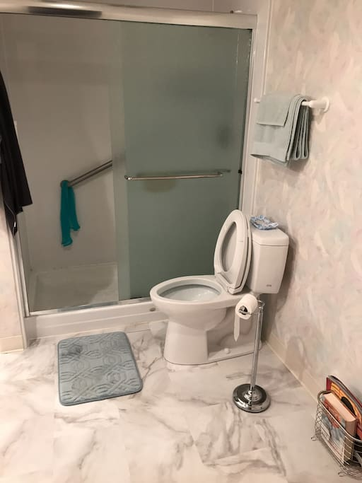 The upstairs bathroom is shared but features a walk-in shower