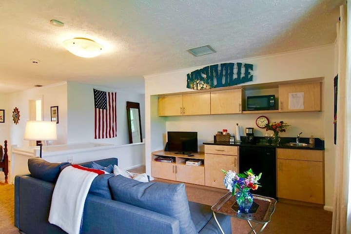 The wet bar has a microwave, small fridge, toaster, coffee maker, and an electric tea kettle.  Essential dishes and utensils are provided.  Light snacks, coffee, tea, and filtered water are provided.