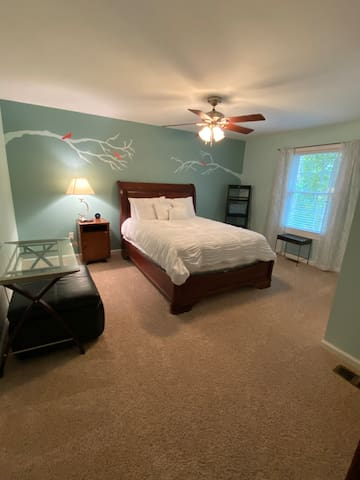 """Queen extra large bedroom with desk, 55"""" flatscreen tv, and spacious closet"""