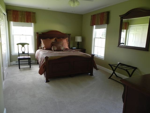 Master bedroom with dimmable lights, ceiling fan and TV