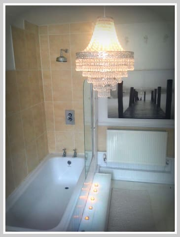 Beautiful large bathroom on the second floor. There is one bathroom for the house.