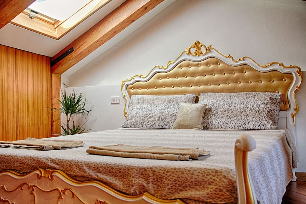 Comfortable King Size Bed in white and Gold. Towels are always provided for your convenience.