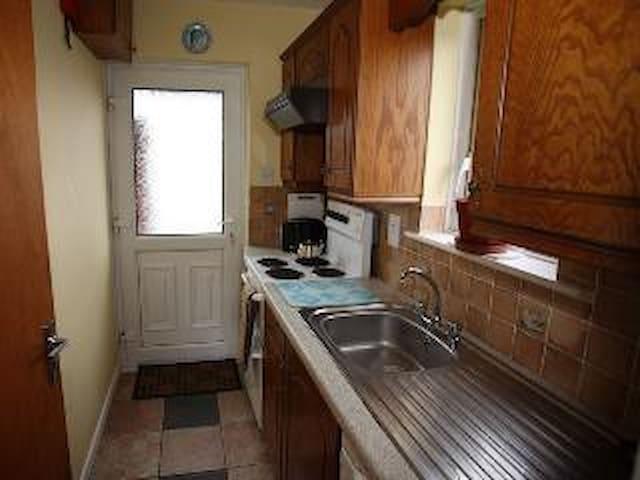 Kitchen with regular amenities