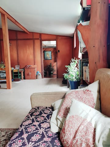Room in a rustic wooden house on permaculture farm